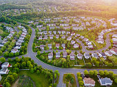 istock Top view aerial with from flying drone over residential district development buildings transportation 1248064953
