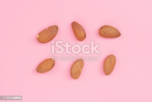 istock Top view Almond set on pink background, Abstract background with Almond pattern. Composition of nuts. Concepts about decoration, healthy eating and food background. Flat lay, top view. Minimal concept. 1140146866