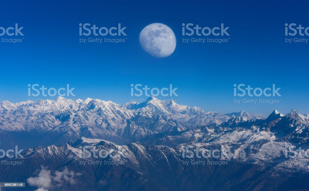 Top view Altitude Mountain Range View with Sunrise between Rocks and young Moon risin stock photo