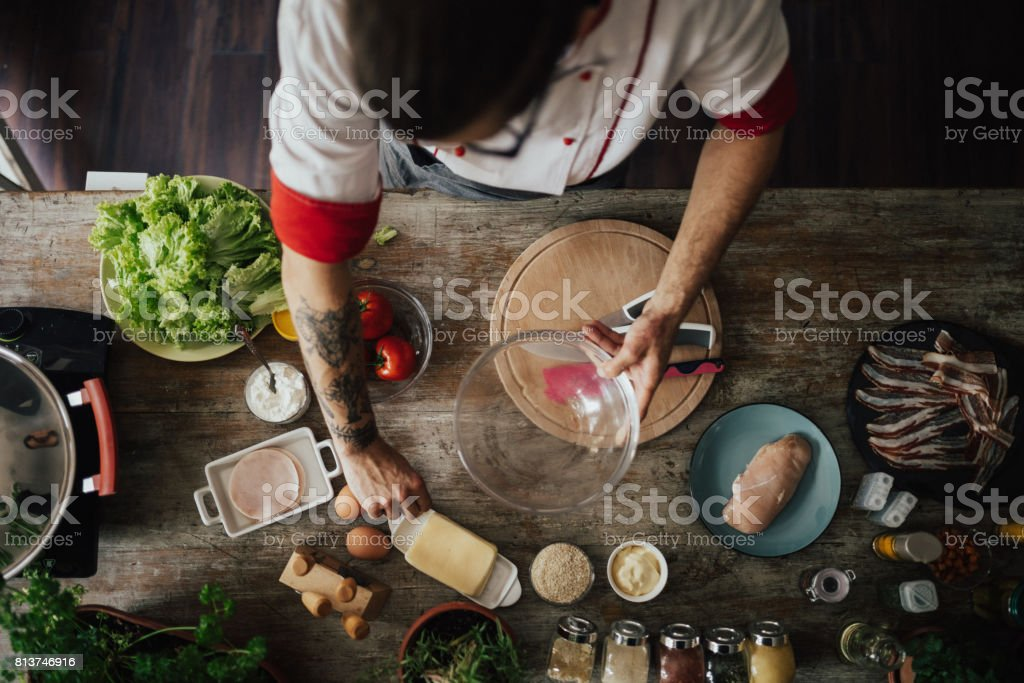 Top view at chef who starts to prepare a meal for dinner stock photo