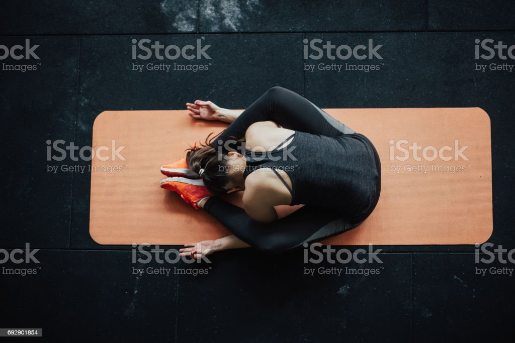 Top View At Yoga Woman In Tortoise Pose Royalty Free Stock Photo