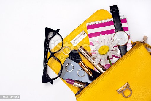 istock Top view bag with make up female fashion accessories. 598794854