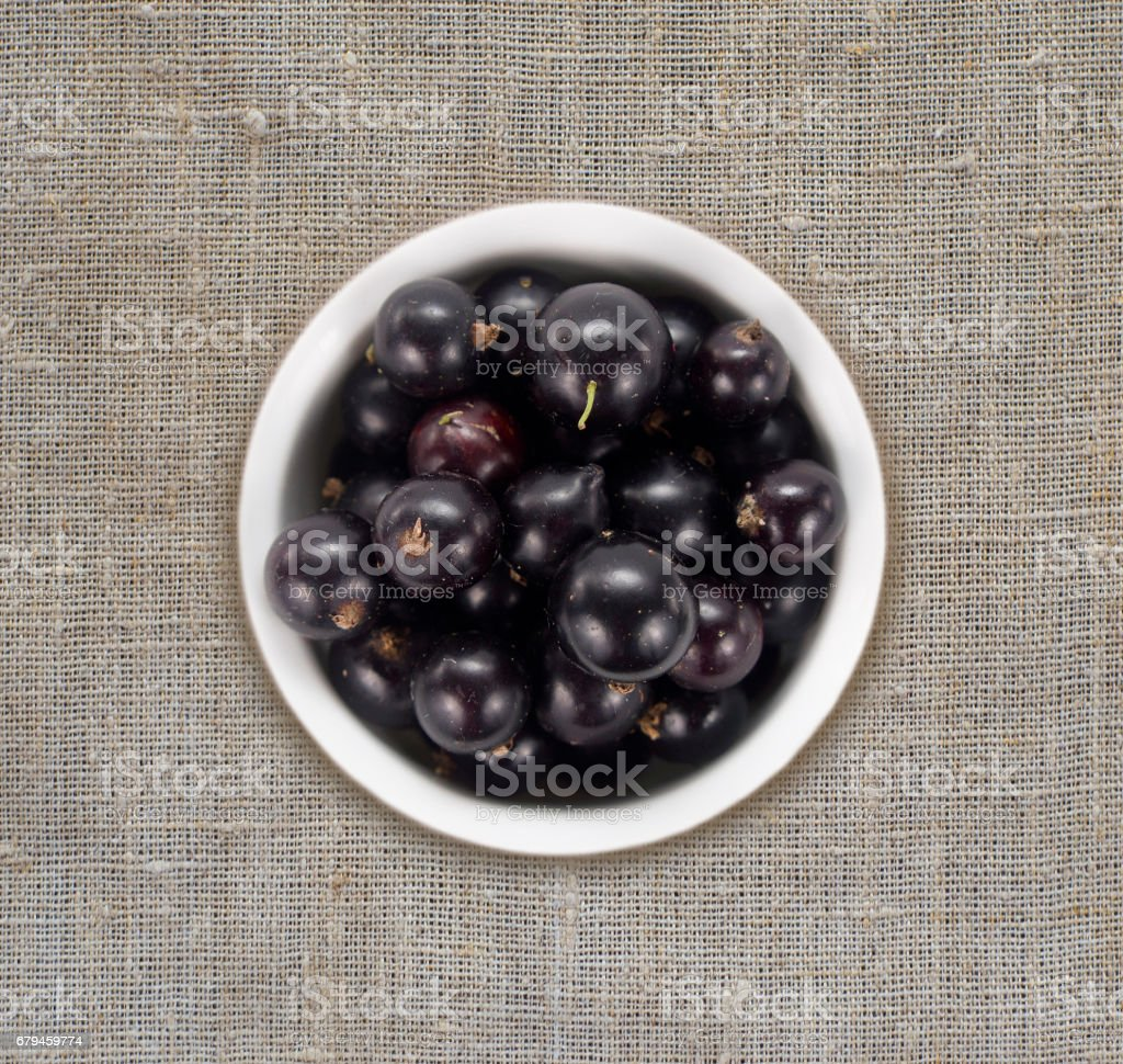 Top view. Black currants on a linen tablecloth. royalty-free stock photo