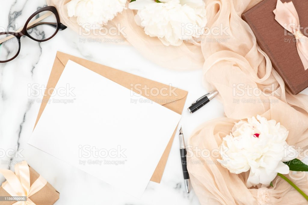 Top View Blank Wedding Invitation Card And Craft Paper