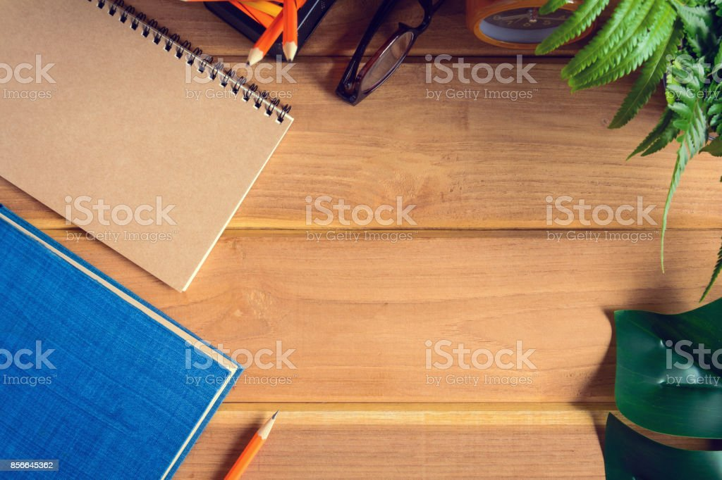 top view book and pencil note on wood table stock photo