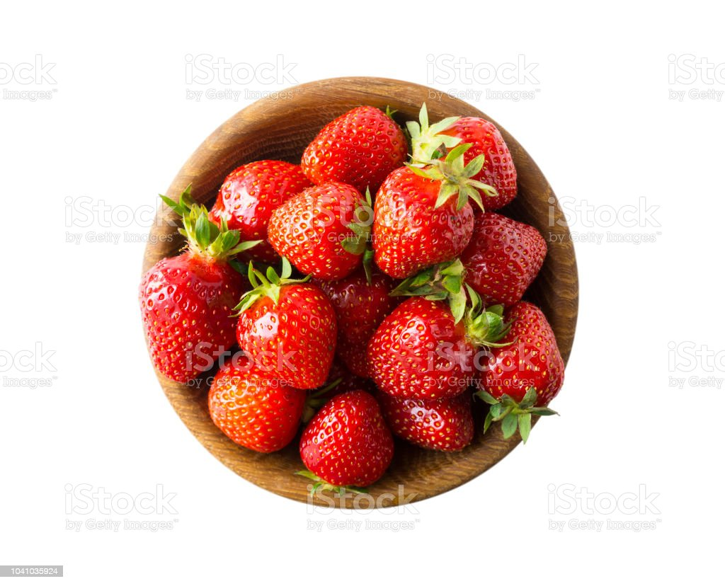 Top view. Bowls with strawberries isolated on white background. Ripe strawberries with a basil leaf close-up. Background berry.  Sweet and juicy berry with copy space for text. stock photo