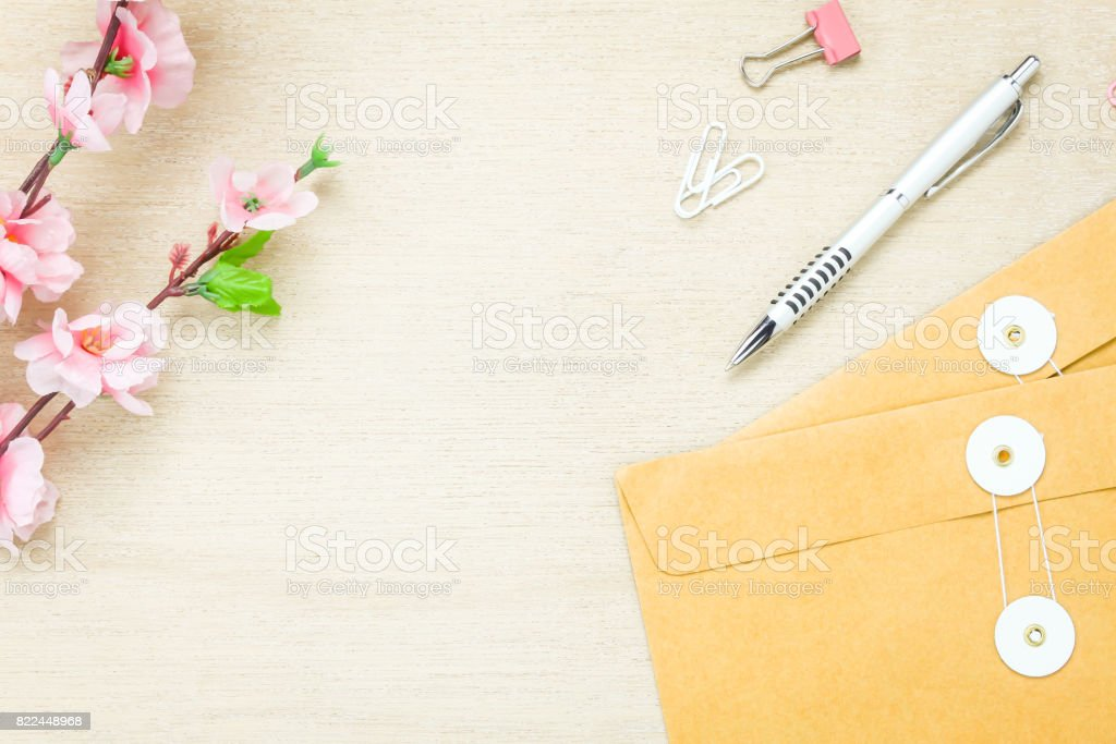 Top view business office desk background.The stationery desktop the ballpen letter flower clip on wooden table background with copy space.flat lay.above. stock photo