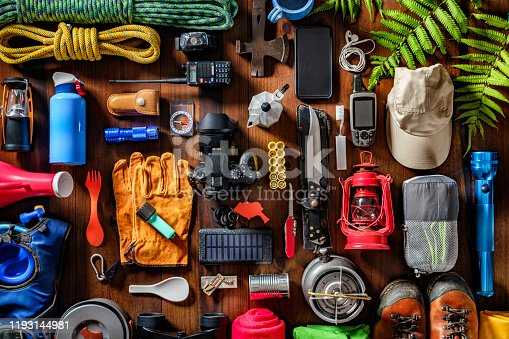 Camping and hiking themes: Top view of large group of gear, equipment and accessories for mountain trips.