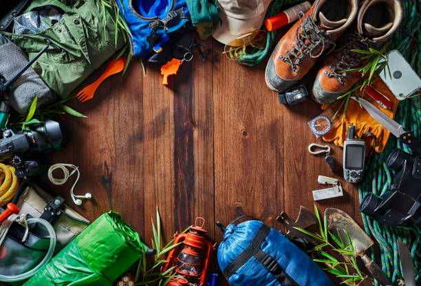 Top view camping and hiking travel and hiking gear, equipment and accessories for mountain trips stock photo