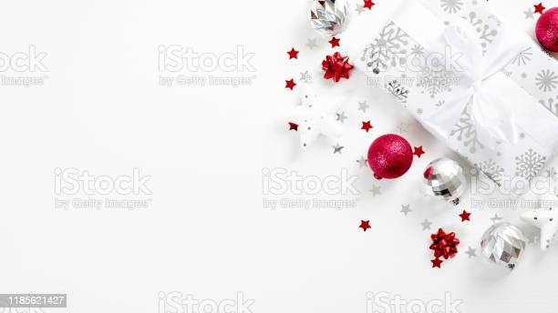 Top view christmas present and silver and red decor elements on white picture id1185621427?b=1&k=6&m=1185621427&s=612x612&h=myuc3w it1ds8bbb36b5slvaht7zsj4crwail5g6kce=