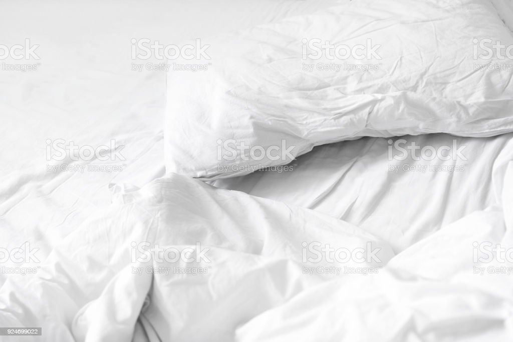Close Up Unmade White Bedding Sheets And Pillow, Messy Bed After Night
