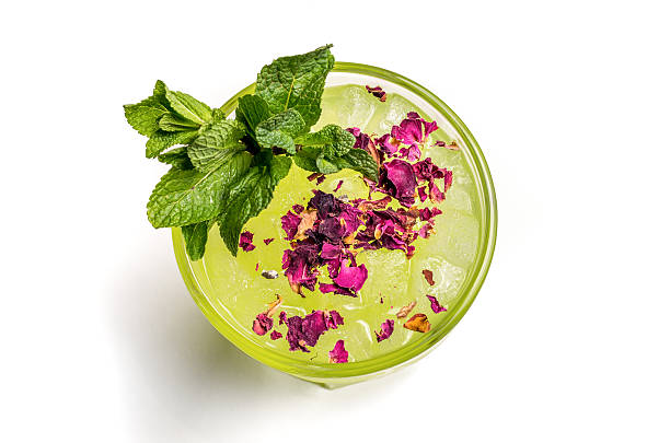top view cocktail green ice mint shadow superior zenithal superior view of a green cocktail with mint and flower decored mint leaf culinary stock pictures, royalty-free photos & images