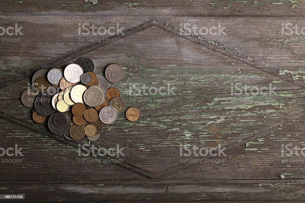 Top view coins on old wooden desk with copy space stock photo