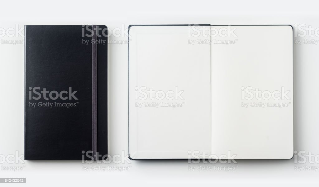 Top view collection of black notebook on white background desk stock photo