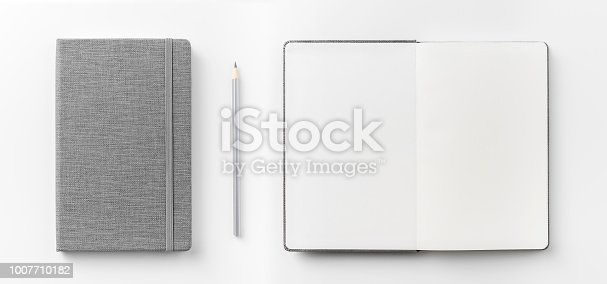 istock Top view collection of  grey notebook front, back pen, and white open page isolated on background for mockup 1007710182