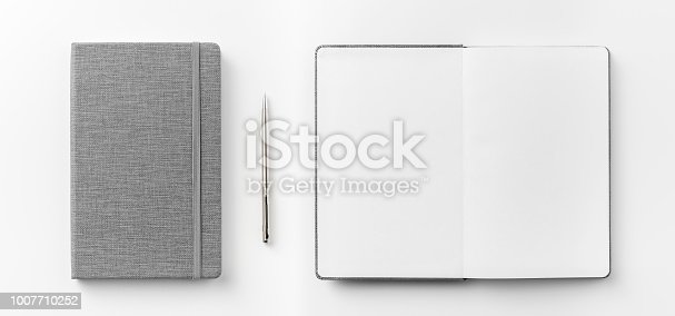 842811354 istock photo Top view collection of  grey notebook front, back pen, and white open page isolated on background for mockup 1007710252