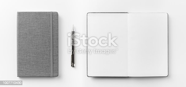 istock Top view collection of  grey notebook front, back pen, and white open page isolated on background for mockup 1007710430