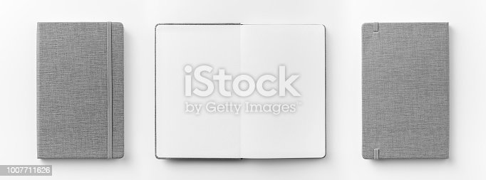 istock Top view collection of  grey notebook front, back pen, and white open page isolated on background for mockup 1007711626