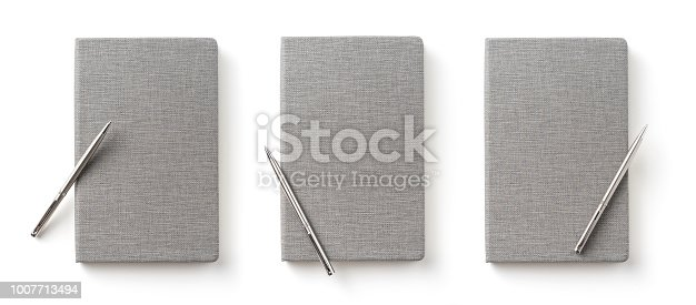 istock Top view collection of  grey notebook front, back pen, and white open page isolated on background for mockup 1007713494