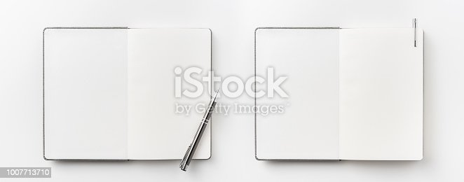 istock Top view collection of  grey notebook, pen, and white open page isolated on background for mockup 1007713710