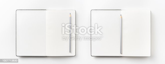 842811354 istock photo Top view collection of  grey notebook, pen, and white open page isolated on background for mockup 1007713830