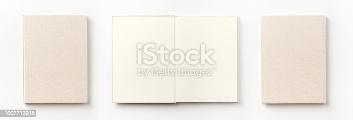 istock Top view collection of  light yellow fabric notebook front, back and white open page isolated on background for mockup 1007713918