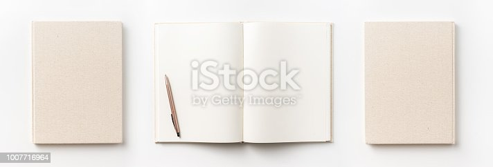istock Top view collection of  light yellow fabric notebook front, back , pen and white open page isolated on background for mockup 1007716964