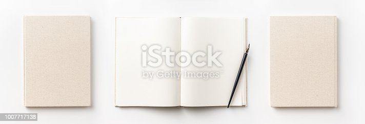 istock Top view collection of  light yellow fabric notebook front, back , pen and white open page isolated on background for mockup 1007717138
