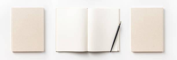 Ansicht von oben-Sammlung von leichten gelben Stoff Notebook Vorder-, Rück-, Stift und weißen offenen Seite isoliert auf Hintergrund für Mock-up – Foto