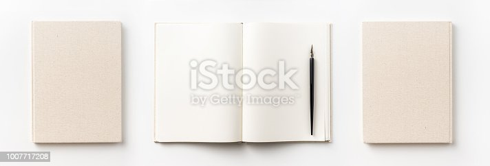 istock Top view collection of  light yellow fabric notebook front, back , pen and white open page isolated on background for mockup 1007717208