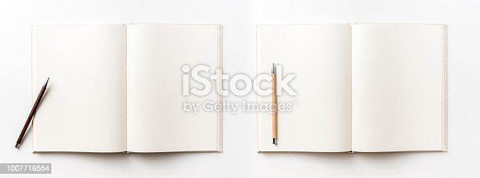 istock Top view collection of  light yellow fabric notebook, pen and white open page isolated on background for mockup 1007716554