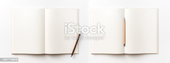 istock Top view collection of  light yellow fabric notebook, pen and white open page isolated on background for mockup 1007716648