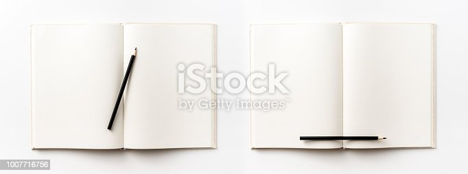 istock Top view collection of  light yellow fabric notebook, pen and white open page isolated on background for mockup 1007716756