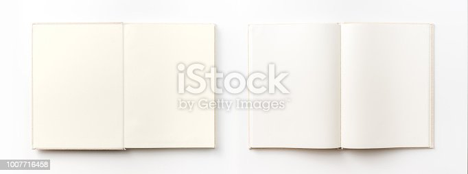 istock Top view collection of  light yellow fabric notebook, white open page isolated on background for mockup 1007716458
