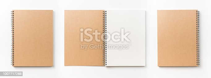 istock Top view collection of  spiral kraft notebook front, back and white open page isolated on background for mockup 1007717266