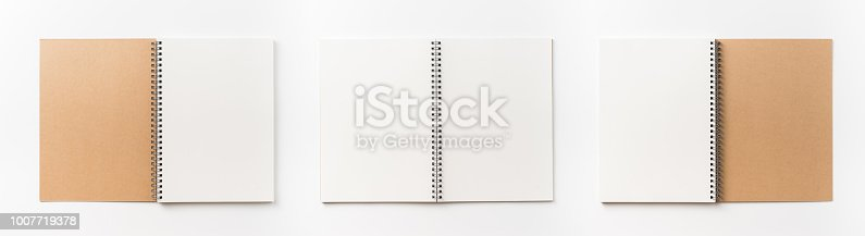 istock Top view collection of  spiral kraft notebook front, back and white open page isolated on background for mockup 1007719378