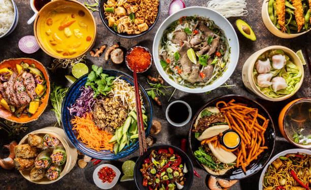 Top view composition of various Asian food in bowl Top view composition of various Asian food in bowls, free space for text vietnamese culture stock pictures, royalty-free photos & images