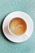 istock Top View Composition with Cup of Coffee on Tablecloth 1002787460