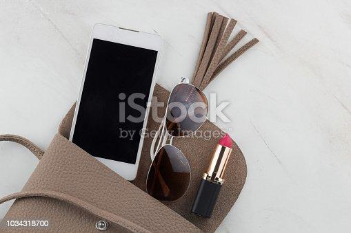 istock top view contents of women  bag 1034318700