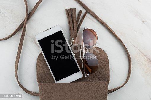 istock top view contents of women  bag 1034318728