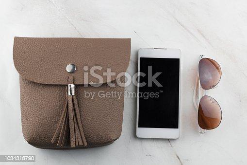 istock top view contents of women  bag 1034318790