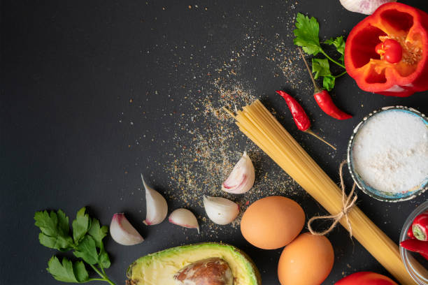 top view copy space of different fresh ingredients for cooking on the black tables stock photo