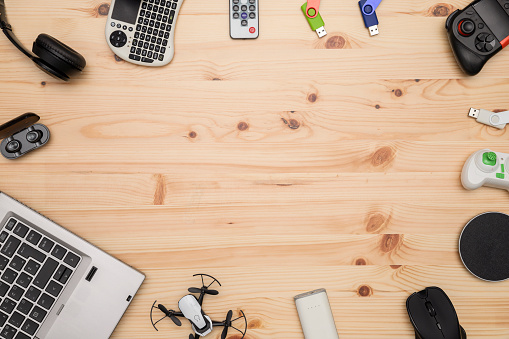 istock Top view Desk with technology gadgets 1169733150