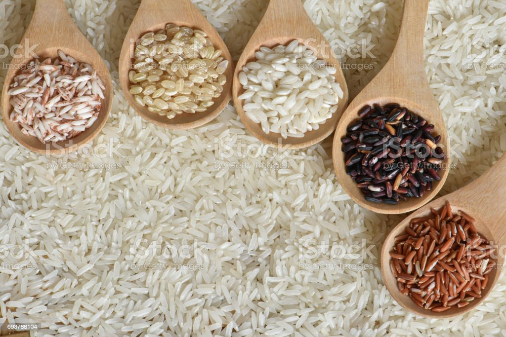 Top view different rice on wooden spoon stock photo