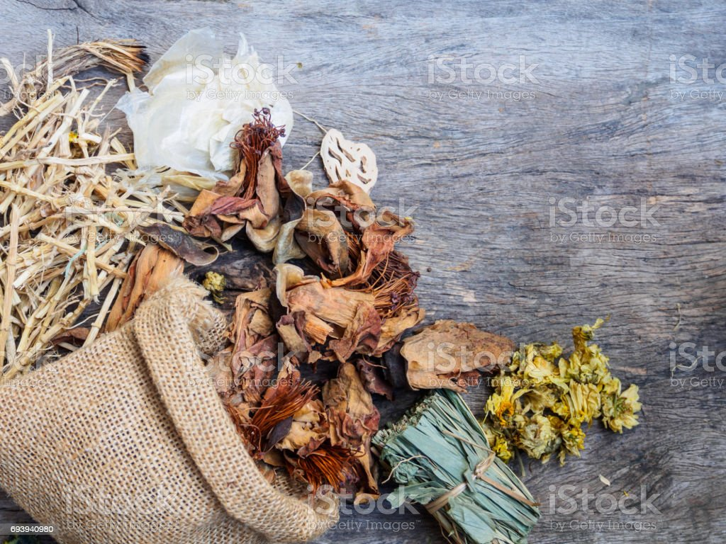 Top view dried herbal natural on wooden background stock photo