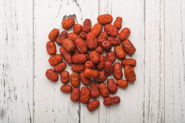 top view dried jujube on white wood traditional chinese herbal medicine top view dried jujube on white wood traditional chinese herbal medicine jujube candy stock pictures, royalty-free photos & images
