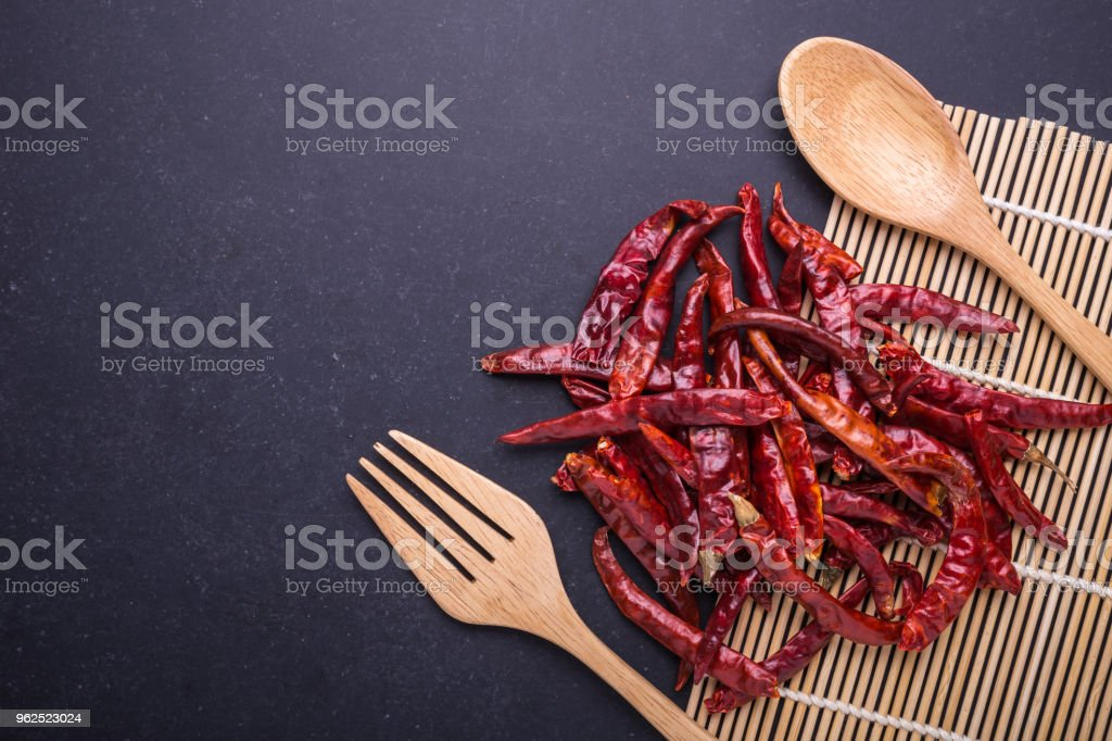 Top view dry red hot chilli on black stone board. Eating spicy concept - Royalty-free Bowl Stock Photo