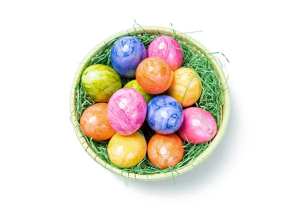 Top View - Easter Eggs in Basket on white Background stock photo