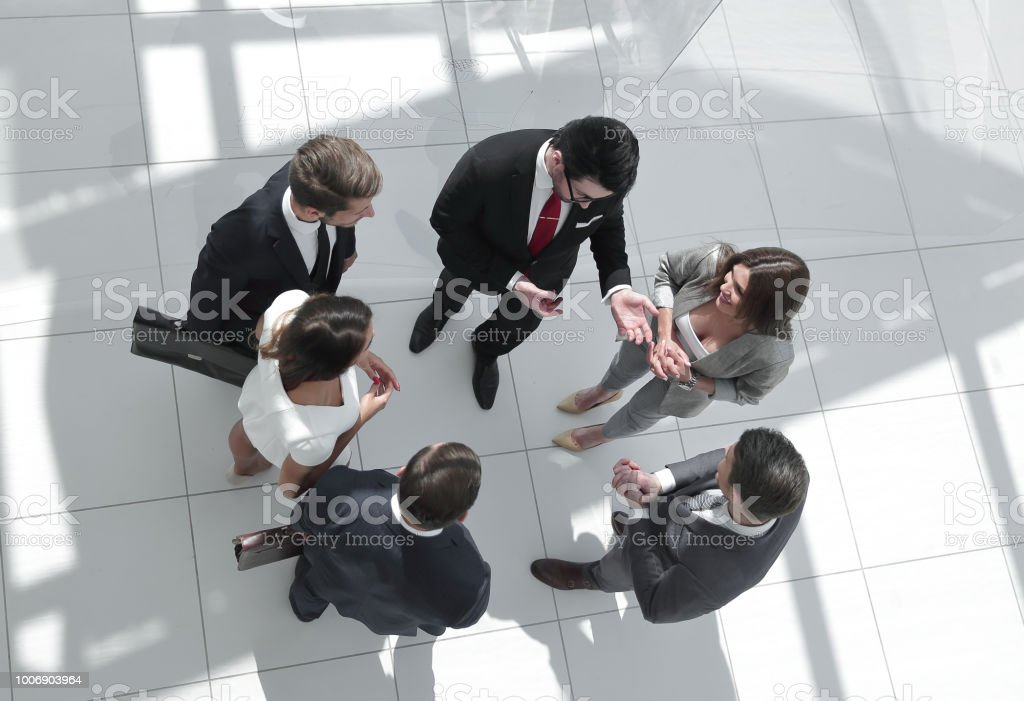 top view. employees discussing current tasks stock photo