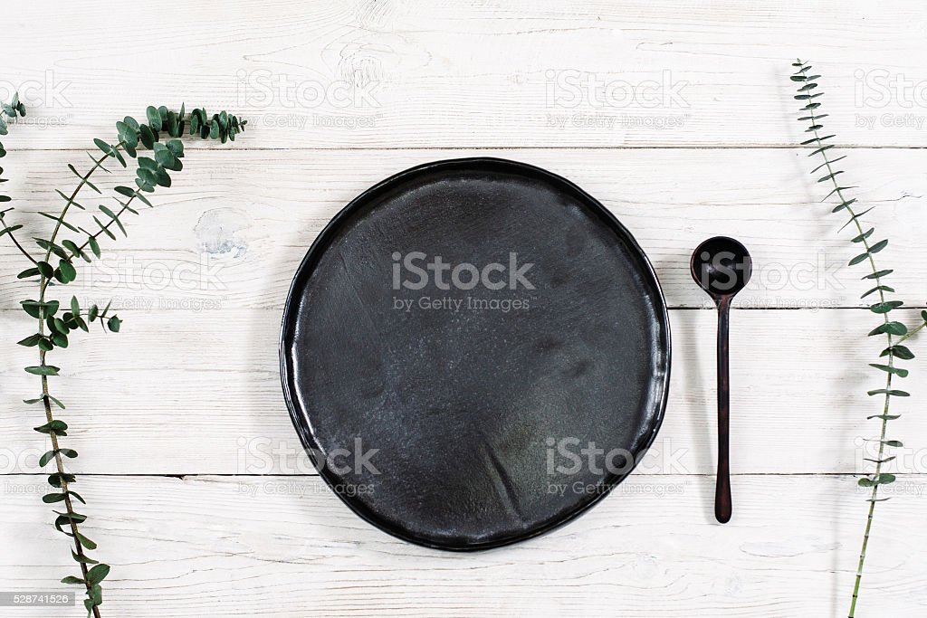 Top view empty black plate and spoon stock photo